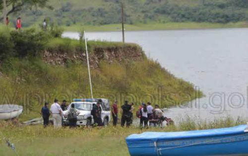 Un sector del camping El Prestamo, en el dique, donde la Policía recoge hoy el cuerpo de la joven hallada si vida.